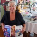 Tricia-bennett-displays-some-of-the-books-she-has-written-for-sale-at-pollys-tearoom