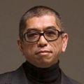 Tadashi-shoji-official-headshot-preferred1-e1377877663185